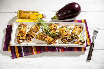 Grilled aubergine slices stuffed with mincemeat  champignons and goat cheese