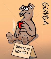 Baer trinkt Tee. Vor ihm steht ein Schild  brauche Honig! Baer trinkt Tee. Vo