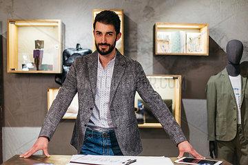 Portrait of confident man in menswear shop