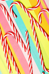 Candy canes on multi-coloured paper