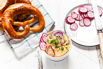 Obatzda with red onion  radish  spring onion and pretzel
