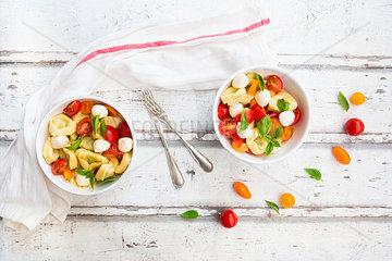 Tortellini salad with tomato  mozzarella and basil