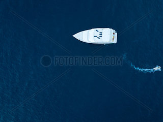 Maldives  Aerial view of yacht and small boat