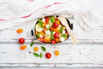 Tortellini salad with tomato  mozzarella and basil in lunch box