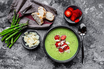 Green asparagus cream soup with strawberry  parmesan and baguette
