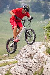 Acrobatic biker on trial bike