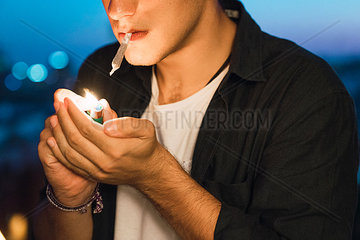 Young man smoking a joint