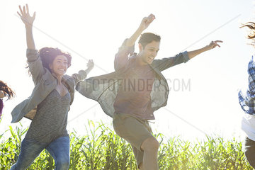 Young people leaping with exuberance
