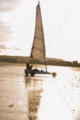 Person land sailing at the beach