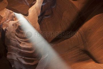 Beam of sunlight shining into Antelope Canyon  Arizona  USA
