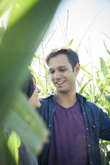 Couple talking together in cornfield