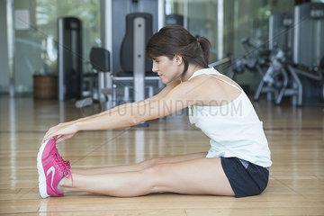 Woman stretching in health club
