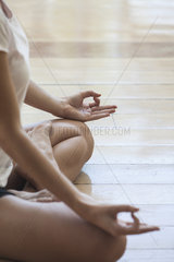 Woman seated in yoga lotus position  cropped
