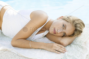 Woman relaxing at poolside  portrait