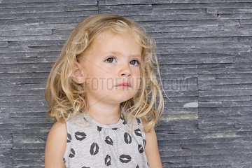 Little girl looking up in thought  portrait