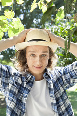 Young man wearing sun hat  portrait