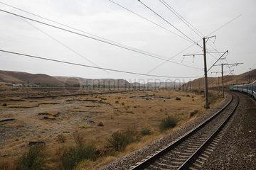Uzbekistan  Bukhara  Railway and power lines running through barren landscape