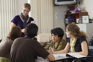 High school teacher leading study group