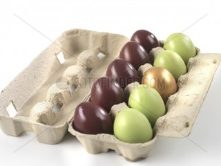 Carton of brightly colored Easter eggs