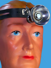 Symbol Arzt mit Stirnleuchte  1928