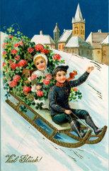 Kinder beim Schlittenfahren  1913