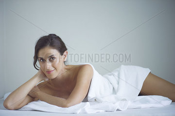 Woman relaxing at spa after beauty treatment