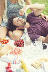 Man enjoying picnic with companion