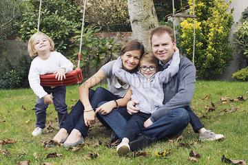 Family relaxing in backyard  portrait