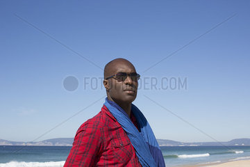 Man at the beach  looking away in thought  portrait