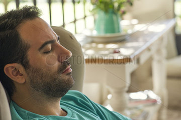 Man napping in armchair