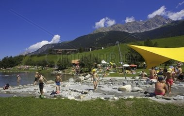Switzerland  Alps  Engadine  Savognin village People at lake in summertime