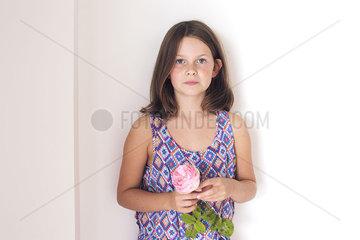 Girl holding rose  portrait