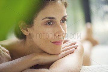 Woman reclining on lounge chair