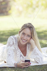 Woman lounging in park  portrait