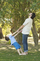 Little boy and father bonding outdoors