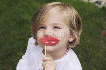 Little girl wearing costume lips