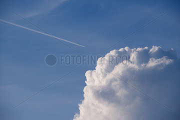 Fluffy cumulus clouds against blue sky