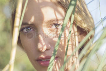 Woman partially obscured by tall grass