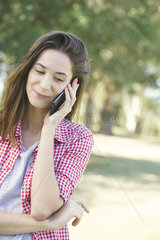 Young woman using cell phone outdoors