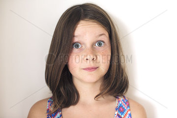 Girl with surprised expression on face  portrait