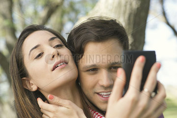 Couple posing for selfie outdoors