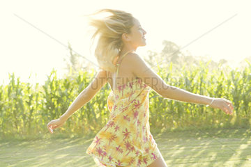 Woman running across open field