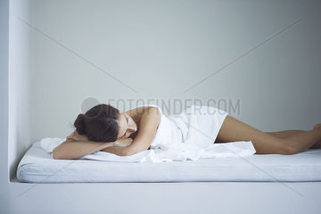 Woman napping at spa after beauty treatment