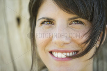 Woman smiling cheerfully  portrait