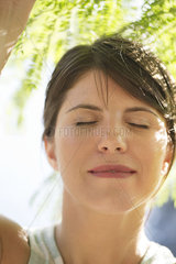Woman with eyes closed outdoors  portrait