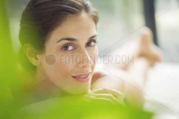 Woman relaxing on lounge chair