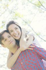 Couple embracing outdoors  portrait