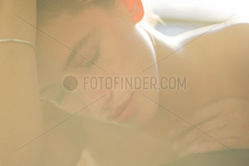 Woman with eyes closed  backlit