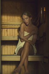 Woman sitting in sauna
