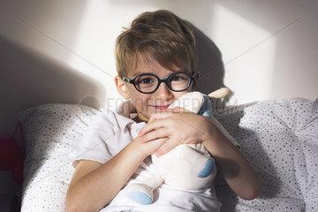 Little boy hugging stuffed toy